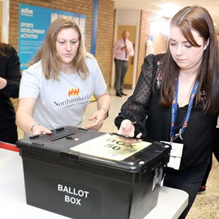 Staff scan ballot box with new digital technology