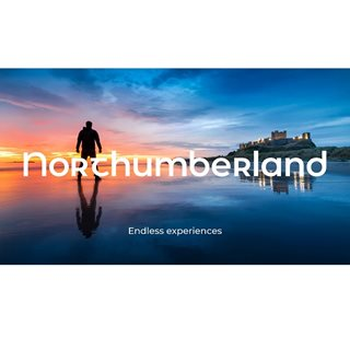 man standing on beach in front of castle with text: 'Northumberland endless experiences'