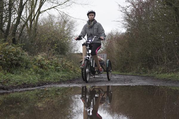 A person riding their bike