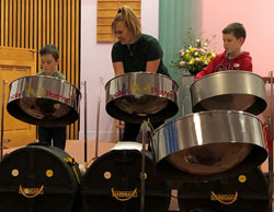 Young students playing steel drums