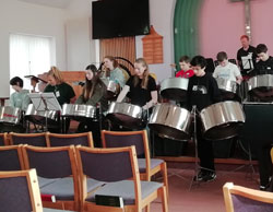 More students playing the steel drums