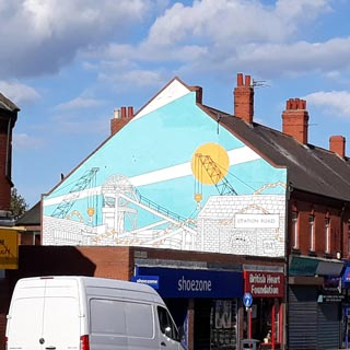 Painting on the side of a building of Ashington