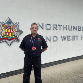 Jim in front of NFRS building