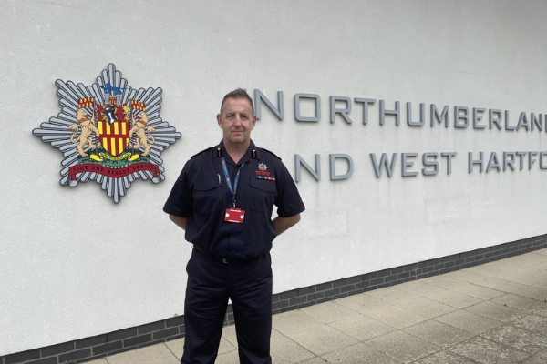 Jim McNeil in front of NFRS building