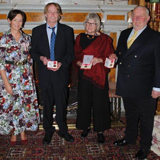 Image demonstrating Duchess presents British Empire Medals to dedicated residents