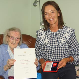 Duchess of Northumberland presenting the awardto Mrs HannahCrackett