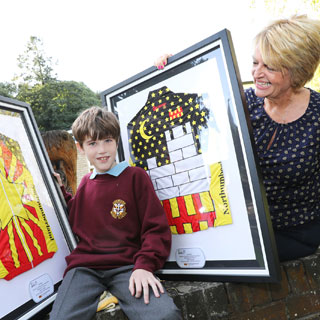 Image demonstrating Winning schools receive their Tour design jerseys