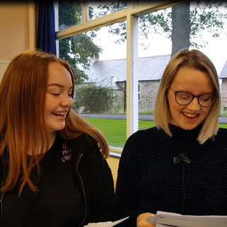 Image demonstrating GCSE students celebrate in Northumberland