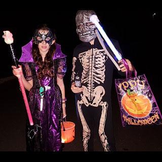 children dressed in Halloween costume
