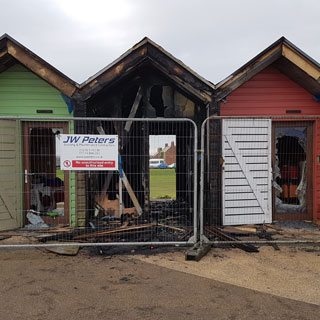 Beach huts damaged by fire