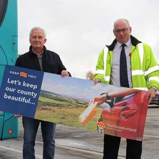 Councillors holding an anti-litter poster