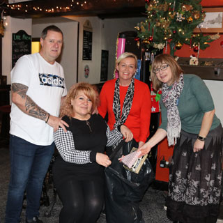 owners of the The Northumberland Arms pub in Bedlington collecting xmas gifts
