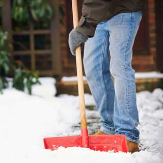 Man clearing snow from a path