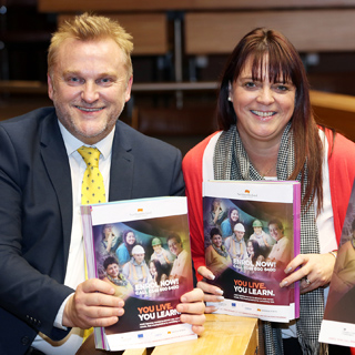 Wayne Daley and Cath McEvoy-Carr holding copies of the new brochure