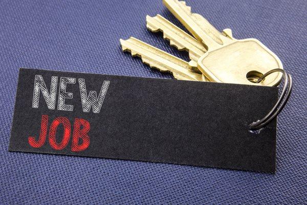 Photo of keys and new job sign