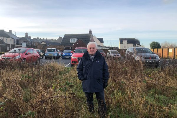 Photo of Cllr Jeff Watson at site of new car park