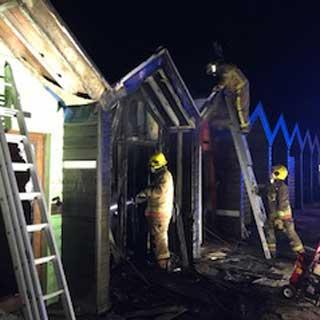 Beach huts damaged by fire