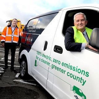 Electric council vans with '100% electric, zero emissions' written on the side