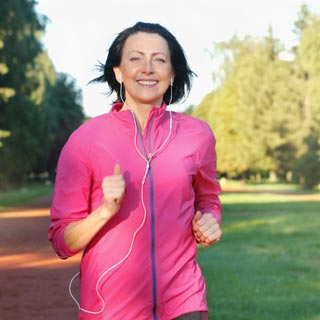 Person running in a park with earphones in