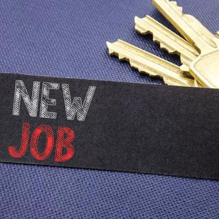 Photo of keys and new job sign