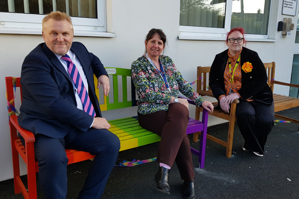 Cllr Wayne Daley on the new seats with children's centre staff