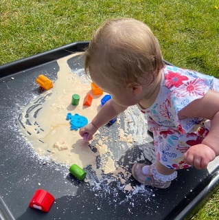 Playing in sand