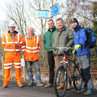 Councillors and railway staff on a new cycle track