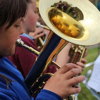 Young girl playing a tuba