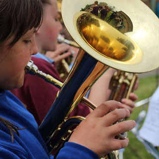 Young girl playing a tuba