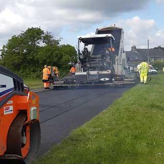 Workers repairing a road