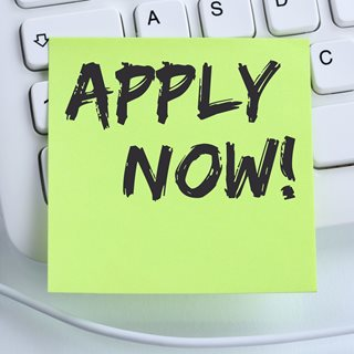 Photo of post-it note saying apply now