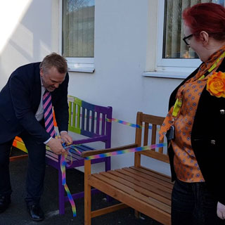 Cllr Wayne Daley cutting the ribbon to launch the new benches