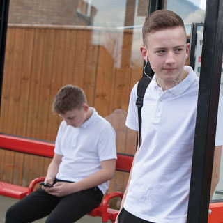 Boys waiting for a bus