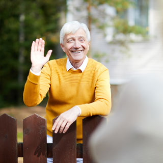 A neighbour waving