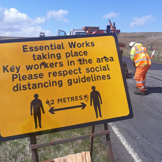 Staff carrying out resurfacing work