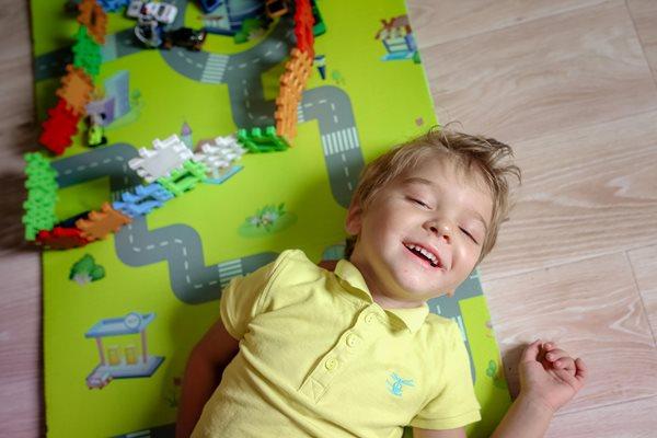 Child on playmat
