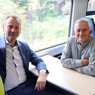 Cllrs Sanderson and Wearmouth seated on the special train