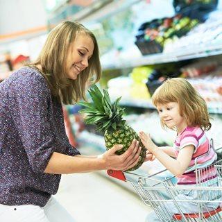 Mum and child food shopping