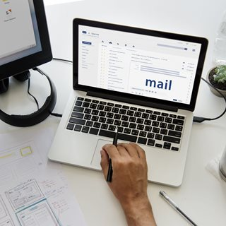 Photo of laptop with emails open