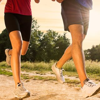Photo of man and woman's legs when running