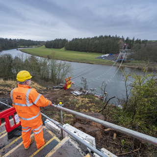 View across the River Tweed with whole bridge deck missing