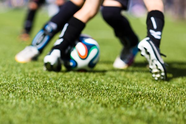 Photo of footballers legs, playing on 3G pitch