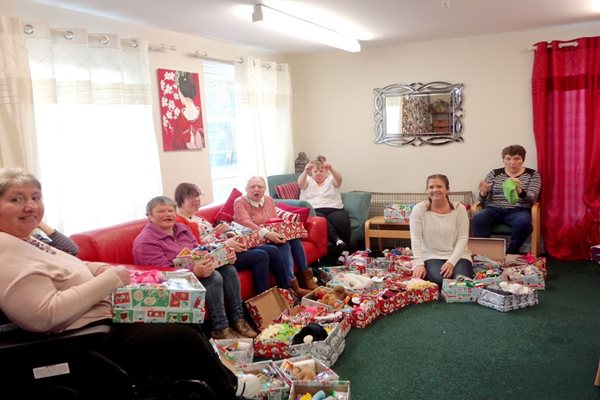Image demonstrating One hundred Christmas shoe boxes collected for needy children