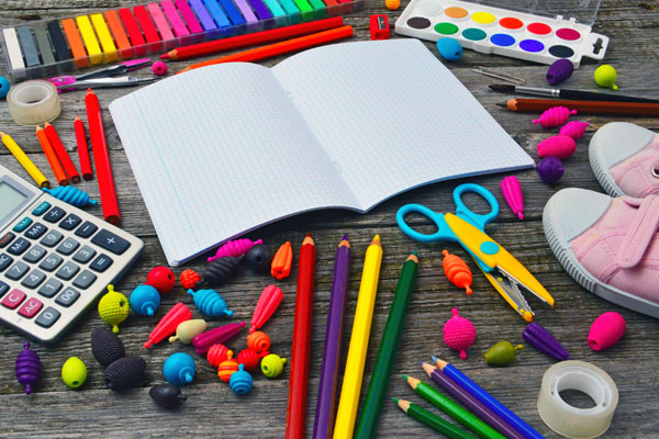 Pens pencils and paper for school
