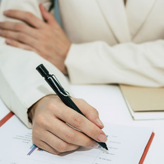 Woman writing a plan document
