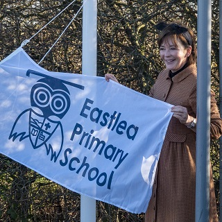 The Duchess with the Eastlea Primary School flag