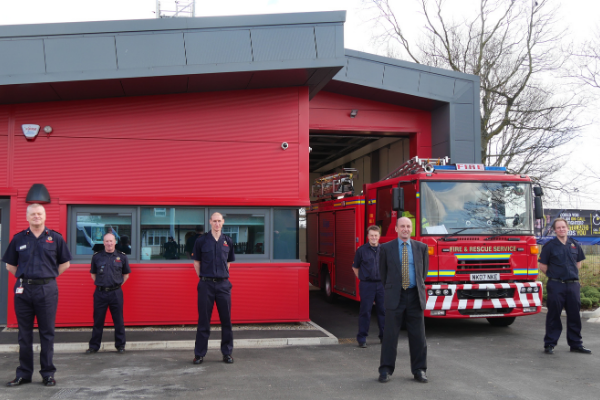 Red fire station and men wearing