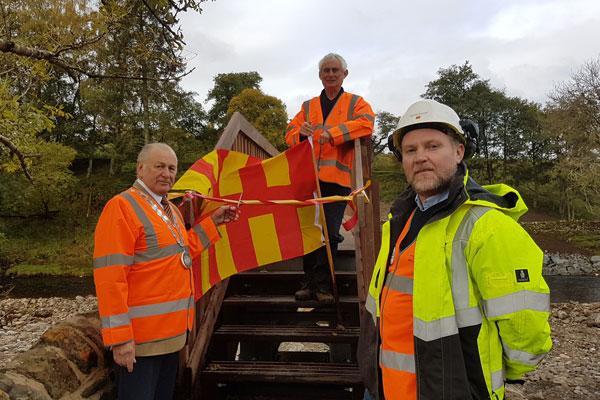 Councillor Ian Hutchinson, Roger Morris and Scott Wharton at the new bridge