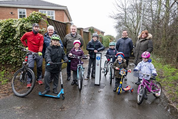 Children and adults with a new cycle signpost