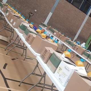 food parcels lined up in sports hall